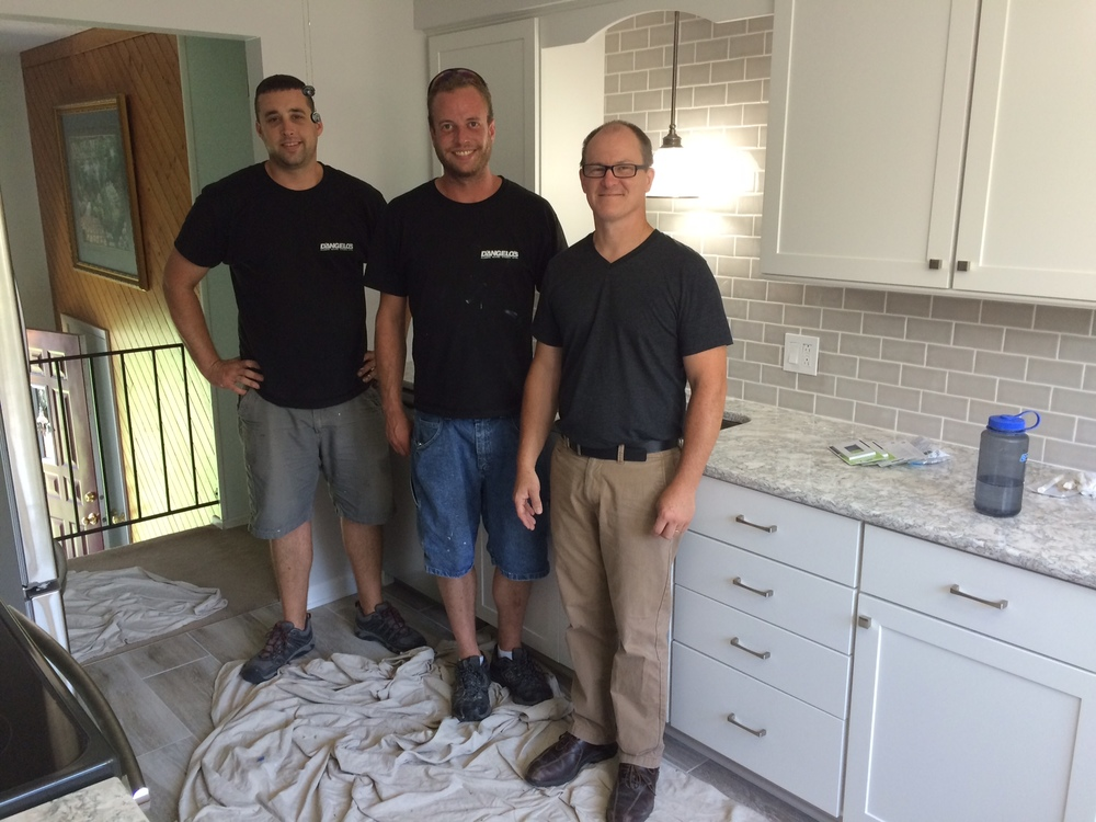From left to right:  Tom Cowd (installer), Kevin Carmody (installer), and Brent Wandel (designer).