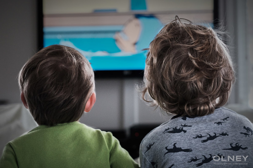 Two brothers looking at tv