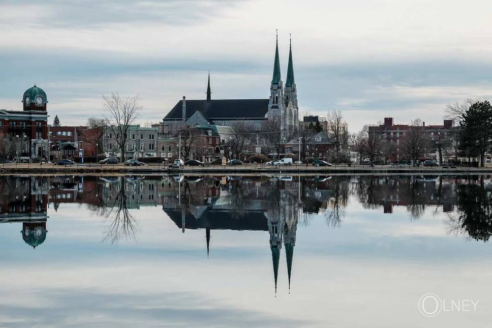 church reflecting in bay saint-francois