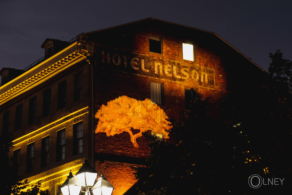 hotel and Jardins Nelson sign at night in Old Montreal