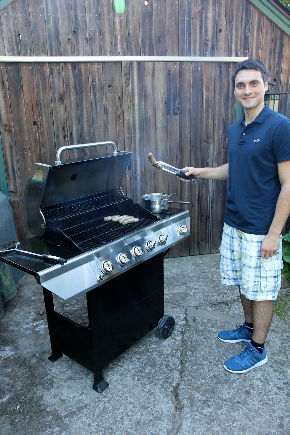 German guest barbecuing bratwurst.