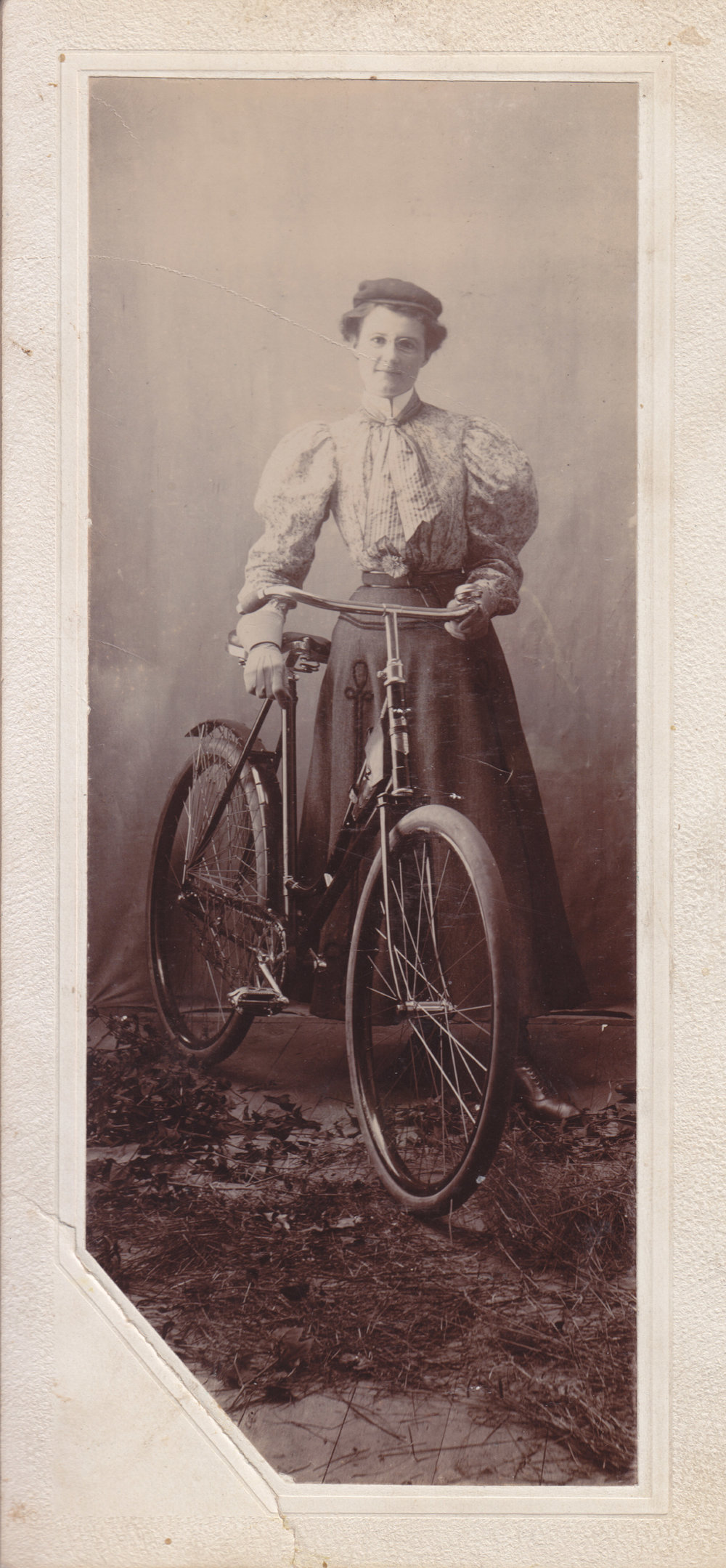Studio portrait with bicycle, mid-1890s.