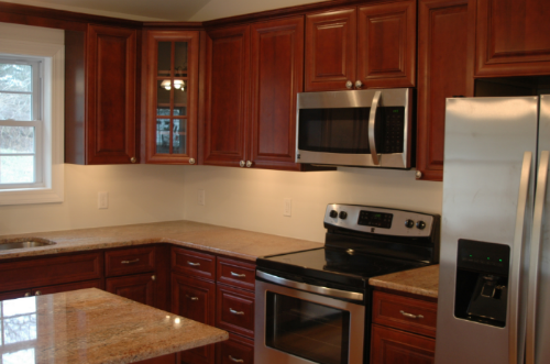 In This Gallery, Youu0027ll See Pictures Of A Spec Home We Did The Kitchen For  In Wolf Classic Cabinetry In Hudson Door Style With A Crimson Chocolate  Glaze.