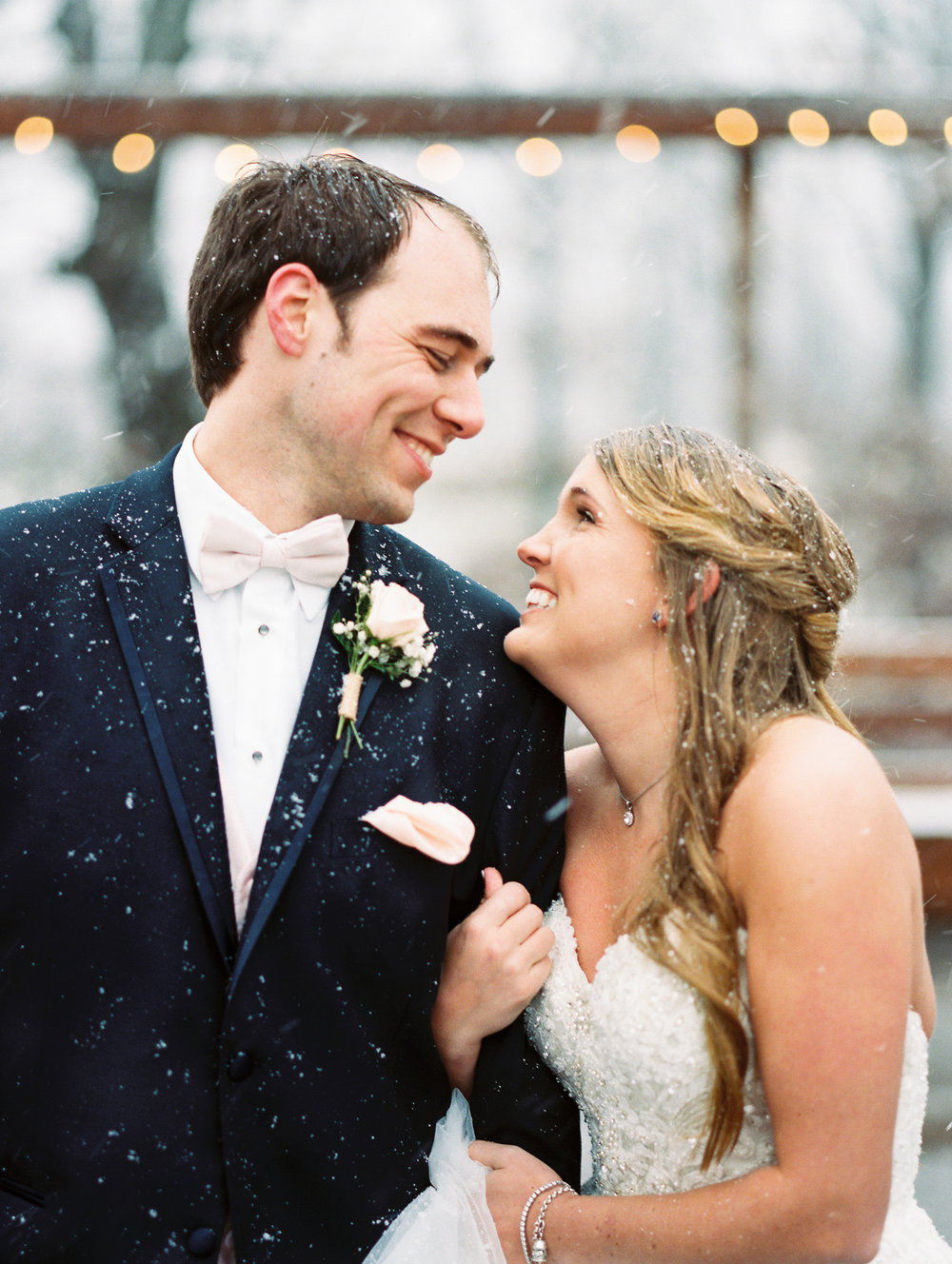 Grant & Ashley - The Sykes photographers are incredible! From the first time we communicated with them to the last pic they were always available to answer our questions and we very flexible. When the weather went from rainy to the perfect snow storm, they adjusted and captured the most perfect snowy, wedding moments. Both husband and wife being photographers gave us so many more beautiful pictures to pick from since they were both constantly snapping photos! They were always easy to communicate with and ready to adjust to any request we made. They put everyone at ease and always had smiles on their faces. If you are looking for the perfect photographers, look no further! We highly recommend Simply Sykes Photography!
