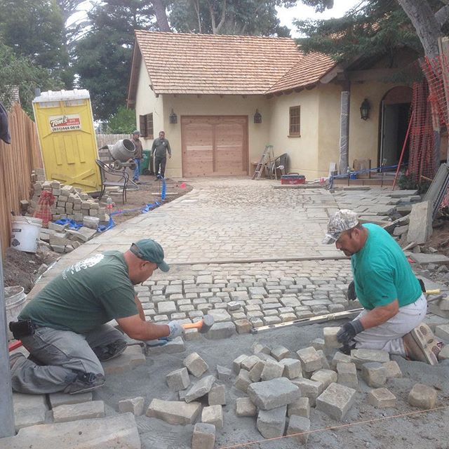 Installing a cobble stone driveway in Carmel.