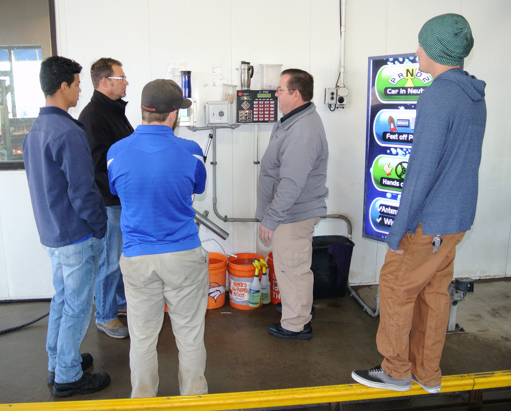 Steve trains the H2O staff on how their new Saleslink Stacker works.