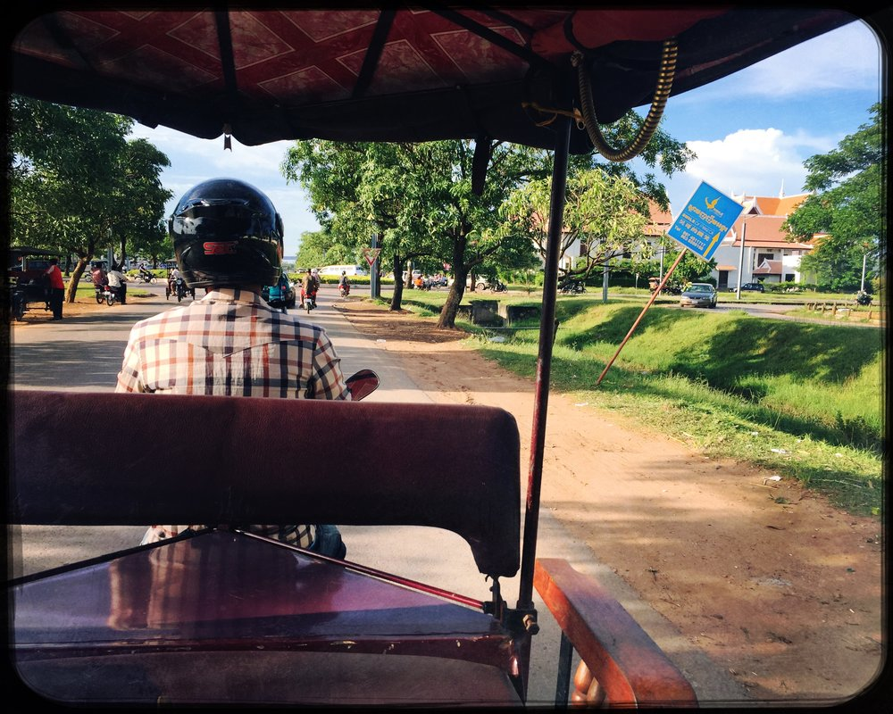 Tuk Tuk through the countryside on the way to Angkor Wat.