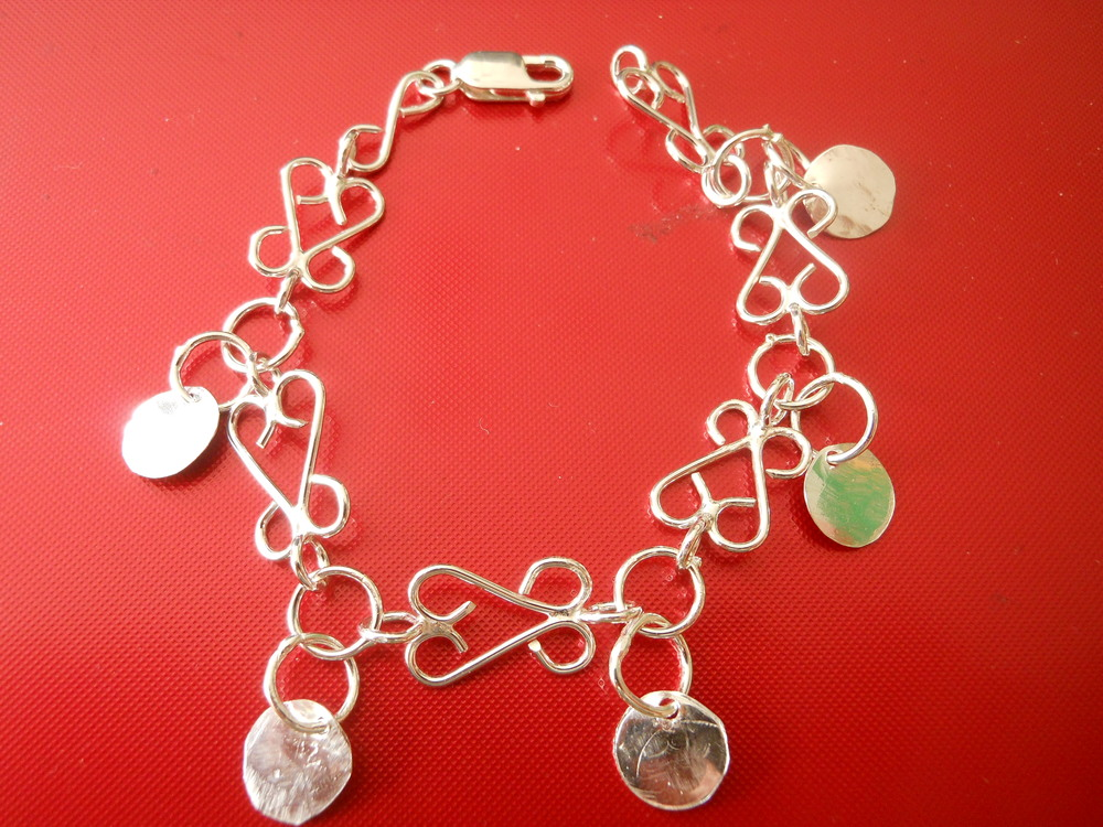 Fine silver bonded braclets and with silver accent coins $150 comes with matching set of earrwires.