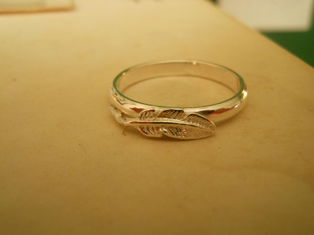 Feather ring $100