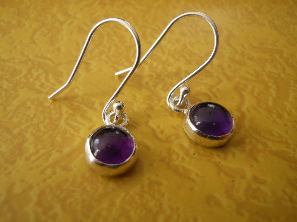 8mm Amethyst earrings $125