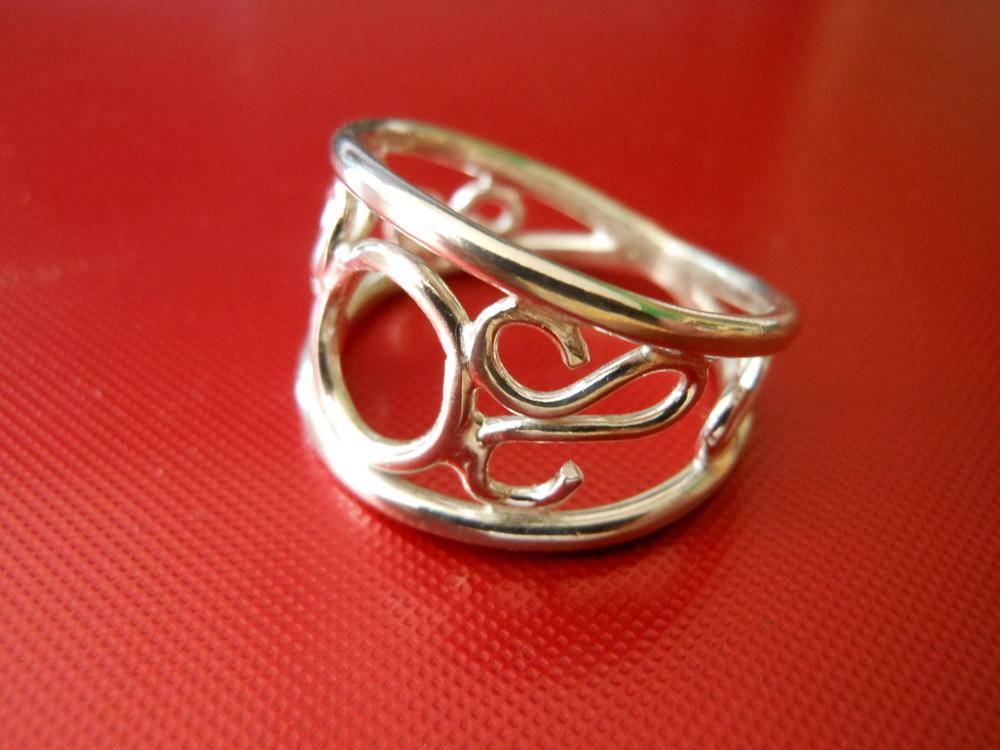 Scroll ring $125