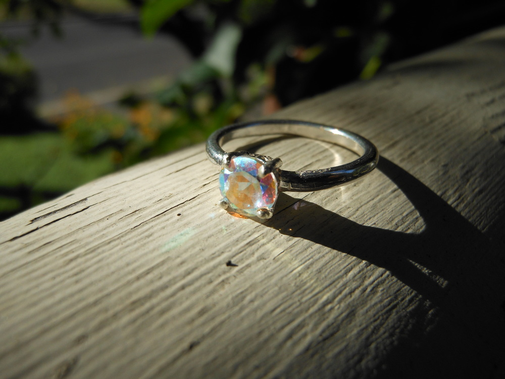 Qpalesent Topaz Solitare Ring $200