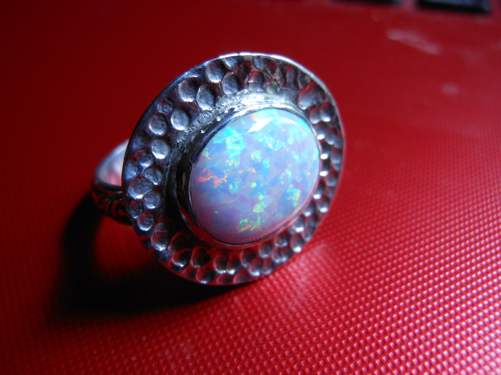 Dimpled Rim Opal $100