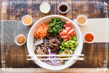 Beef Bulgogi, Shredded Carrots, Kales Salad, Tomatoes, Edamame, Grilled Zucchini, Red Onions, and Shiitake Mushrooms