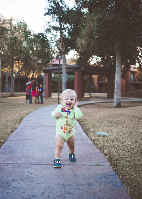 Kids playing and running around create movement, bringing the photo to life.
