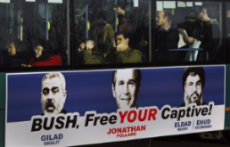 Poster on Israeli bus during Bush's visit in 2005, juxtaposing Bush with the leaders of Hamas and Hezbollah