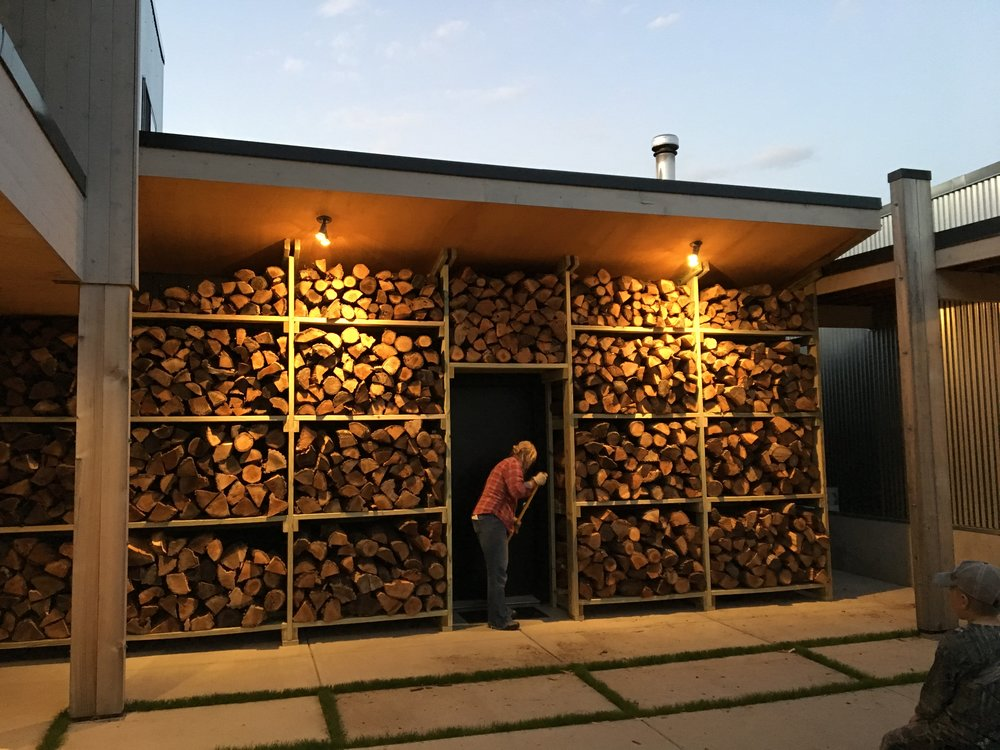 Washing this wall of wood with light gives it a stunning effect at night.