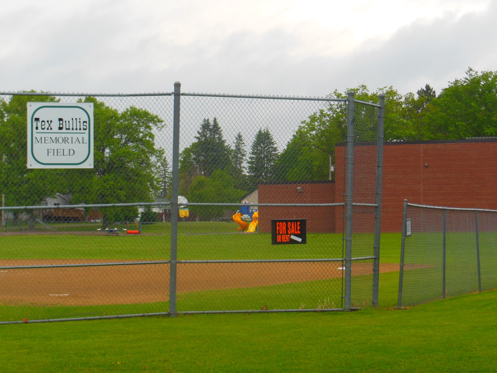 A heavy sign & saddening sign of a dying town. The freshly built school and baseball field in Palisade, MN were not enough to attract new students -- and now they are both for sale. The small town's children now ride 25 minutes to a nearby town for schooling.