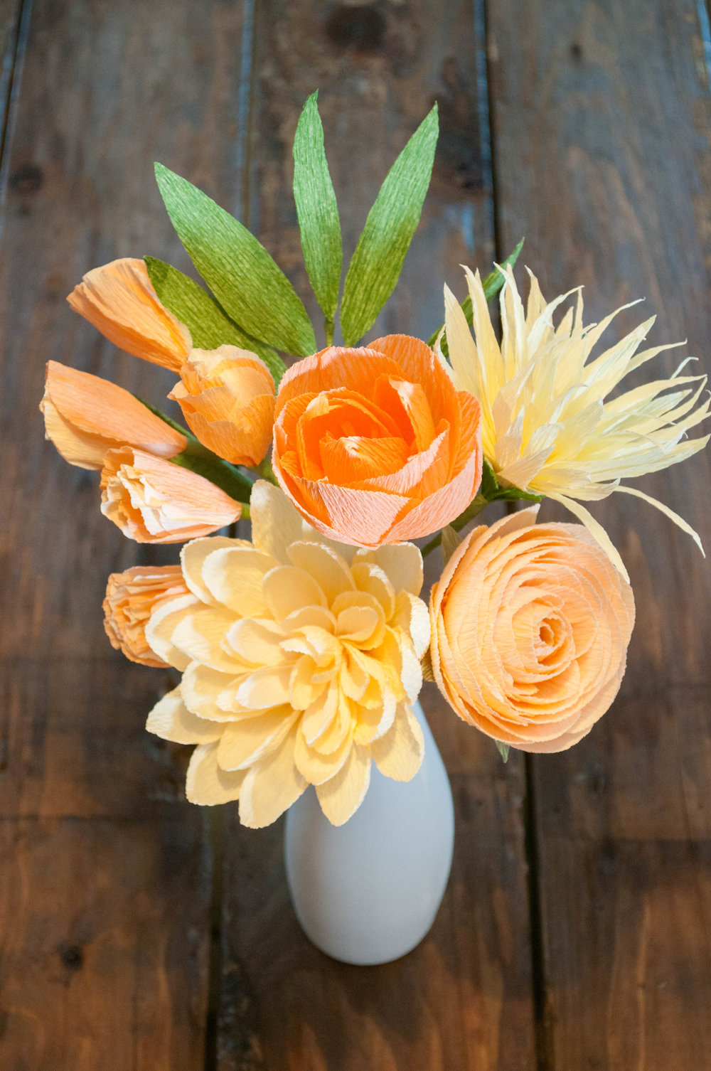 Build this 6-stem bouquet! Recipe: French vanilla dahlia, peach tulip, peach ranunculus, yellow water lily, peach sweet pea, grass green leaves.