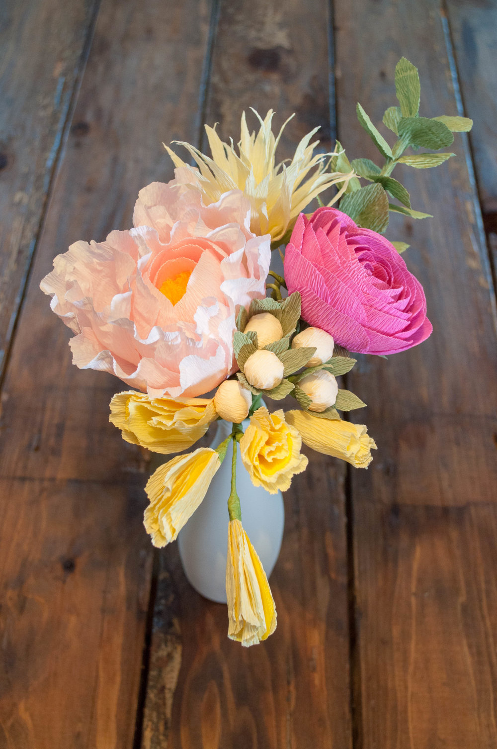 Build this 6-stem bouquet! Recipe: Blush peony, yellow water lily, pink ranunculus, yellow sweet pea, cream berries, eucalyptus.
