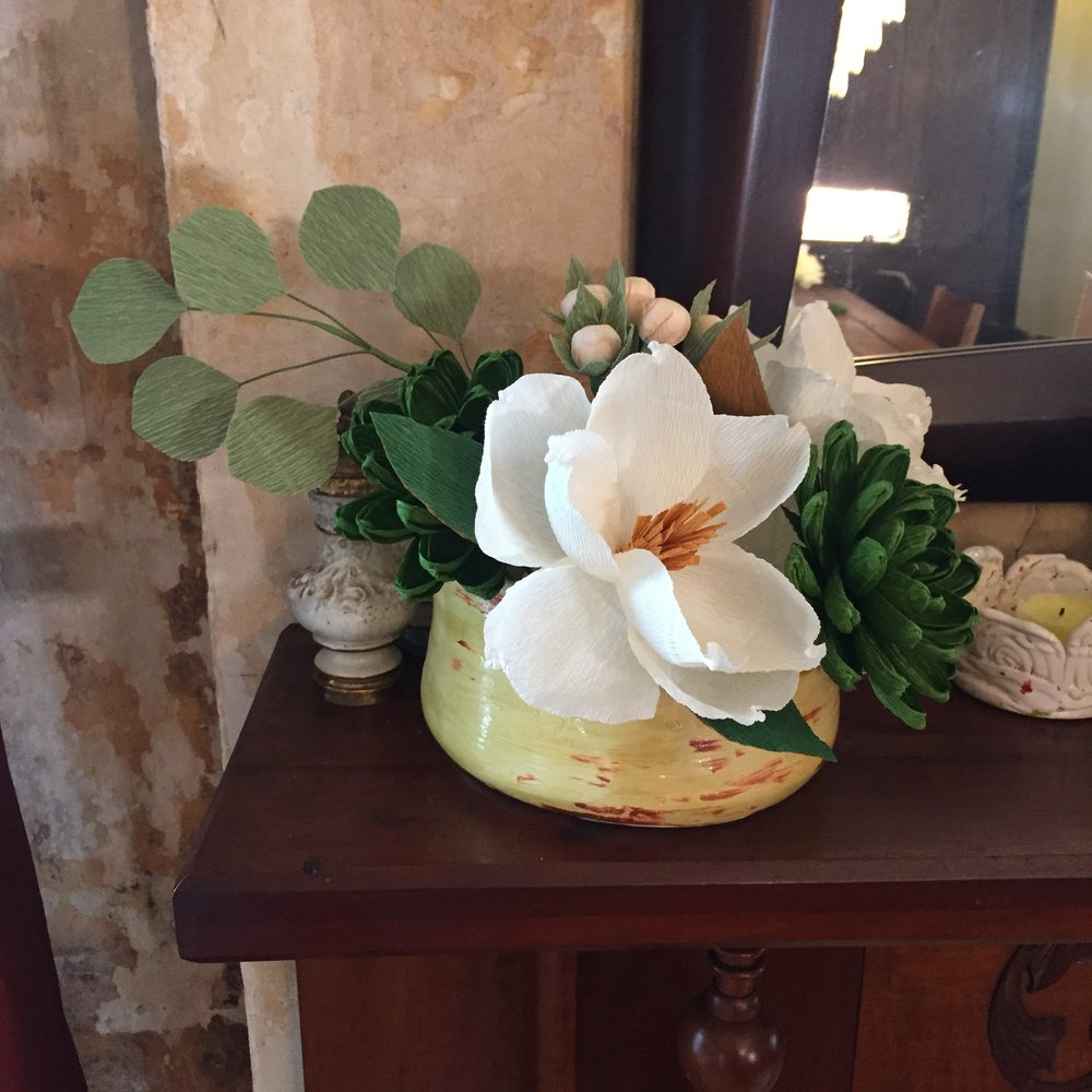 Build this 6-stem bouquet! Recipe: two cream magnolias, two green succulents, cream berries, silver dollar eucalyptus.