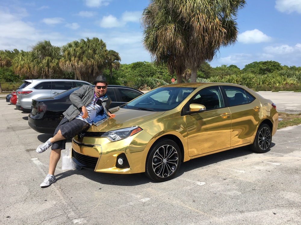 Q: Don't I look really hot modeling this dope Gold Toyota Corolla at their 50th anniversary party in Miami? A: Yes. In more ways than one.