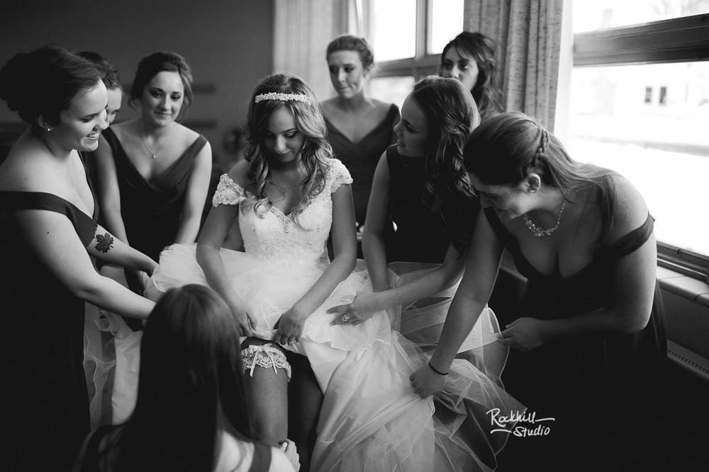 marquette-wedding-photographer-rockhill-studio-bride-getting-ready-garter.jpg