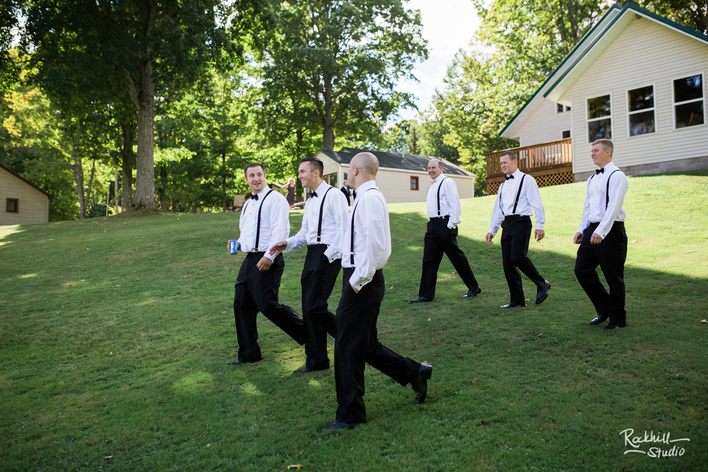 rockhill-studio-newberry-michigan-wedding-groomsmen-walking-fun.jpg