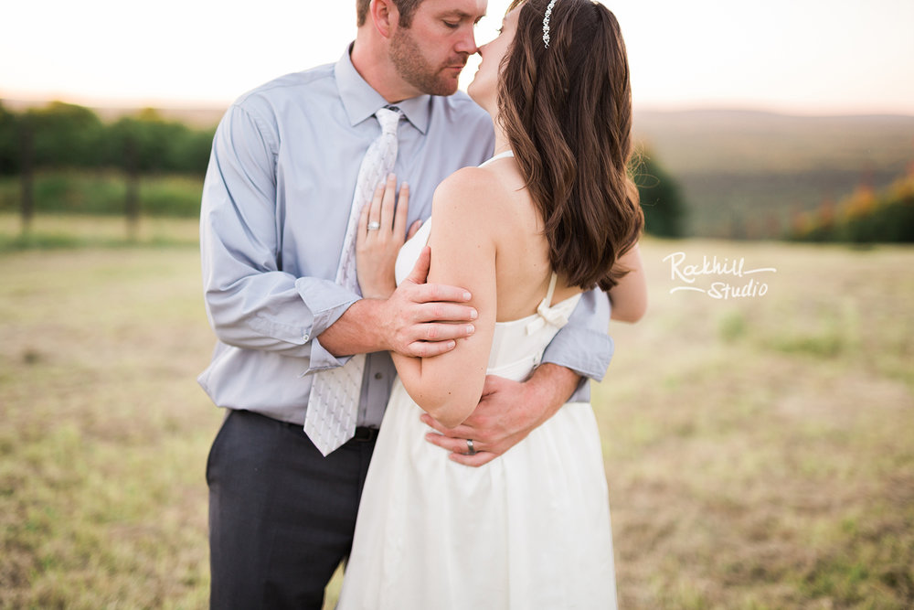 traverse city wedding photographer bride and groom on ski resort at sunset