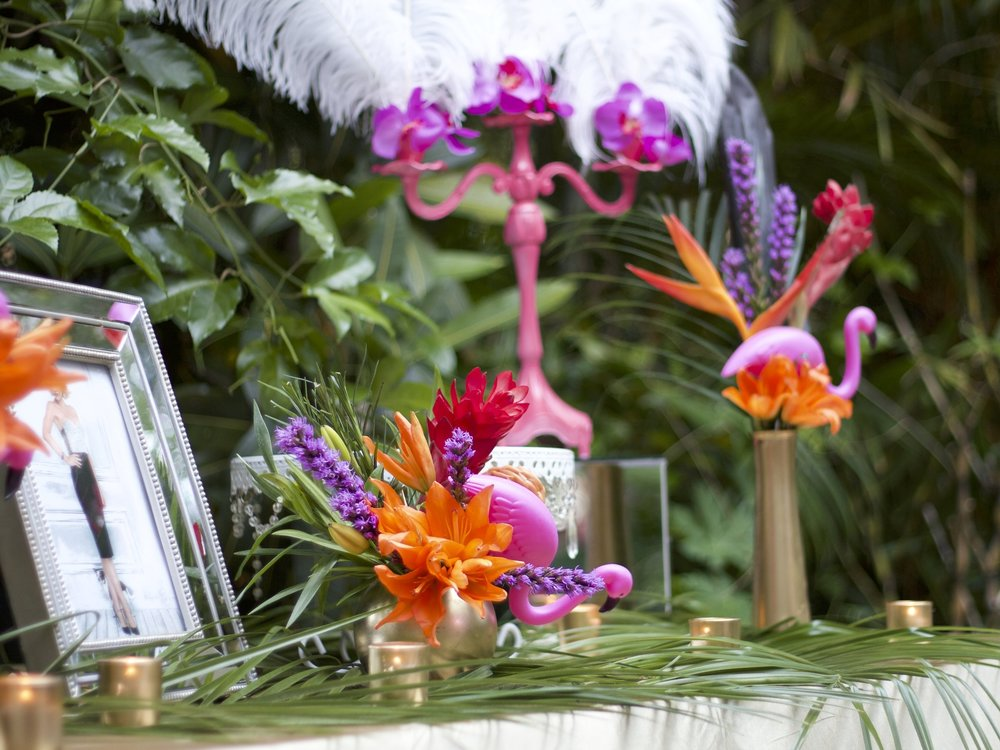 Whimsical tablescapes made a big impact because of the colorful flowers.