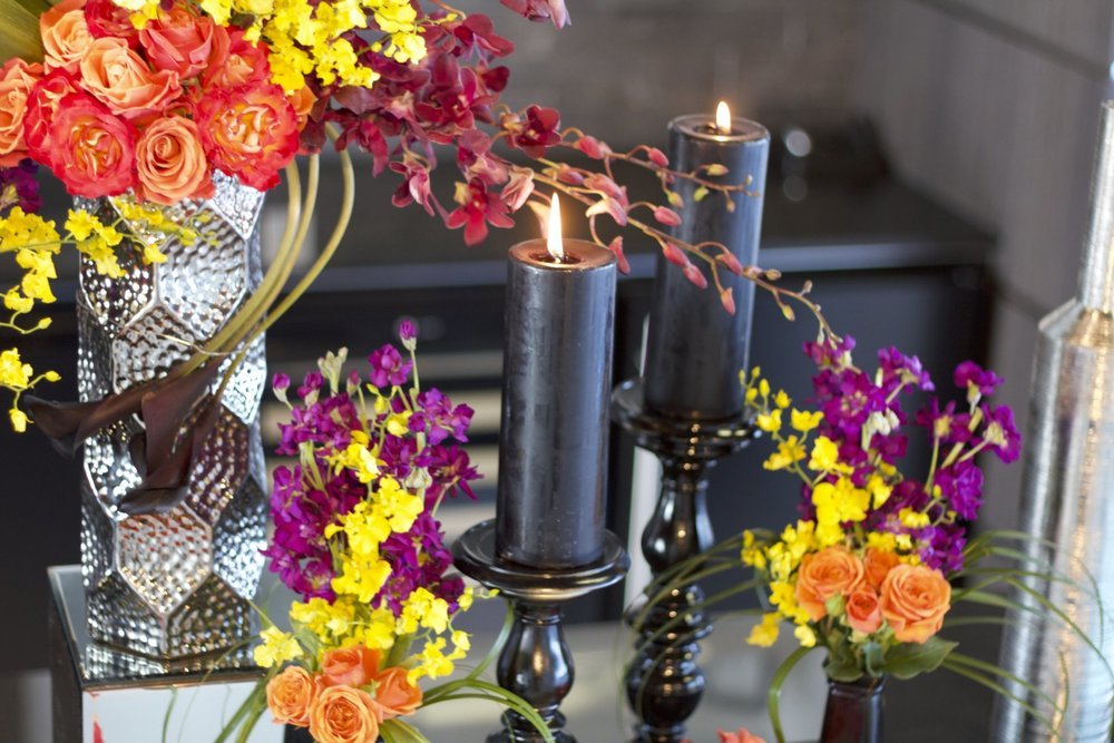 Corporate events shine with colorful flowers like the tall arrangements and centerpieces pictured here.
