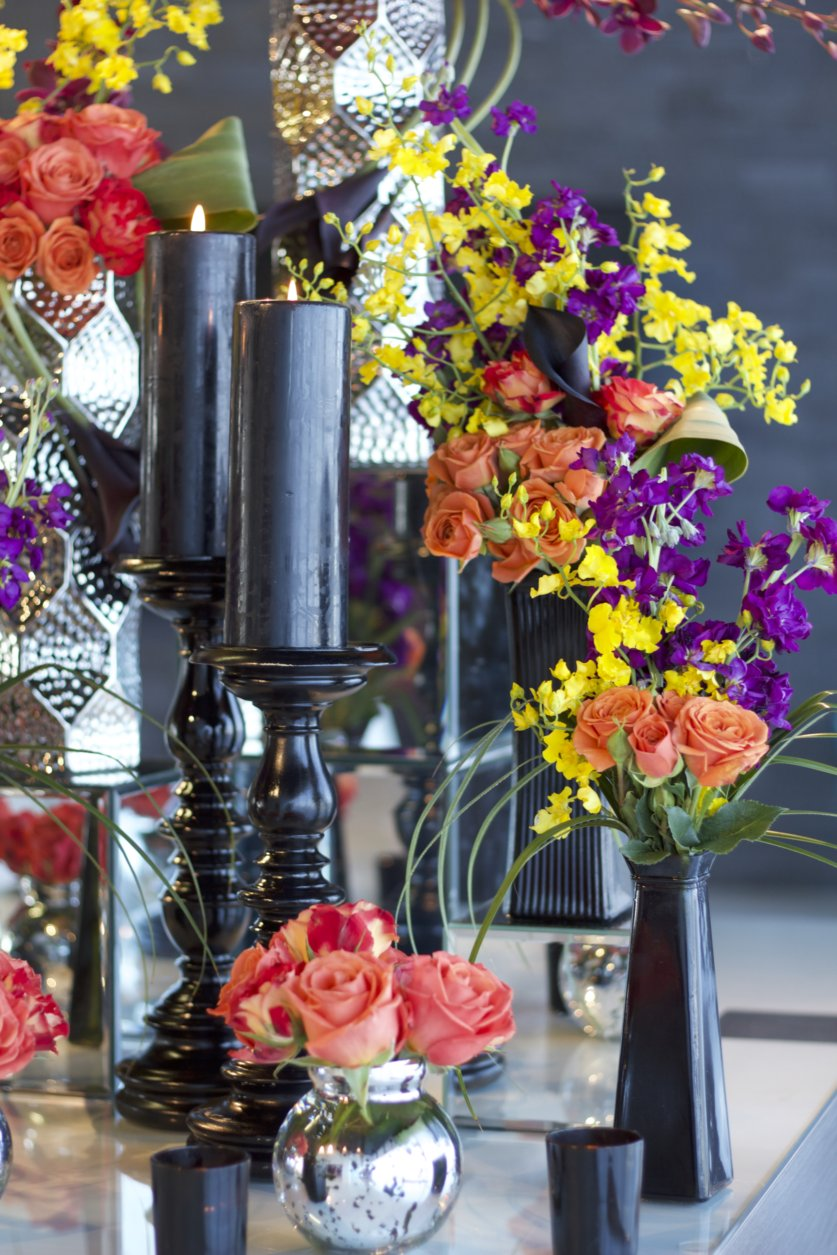 By mixing tall arrangements and short arrangements, you can give depth to your floral displays at corporate events.