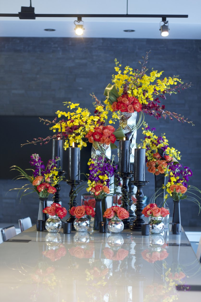 Large groupings of tall arrangements are sure to dazzle at any corporate event.