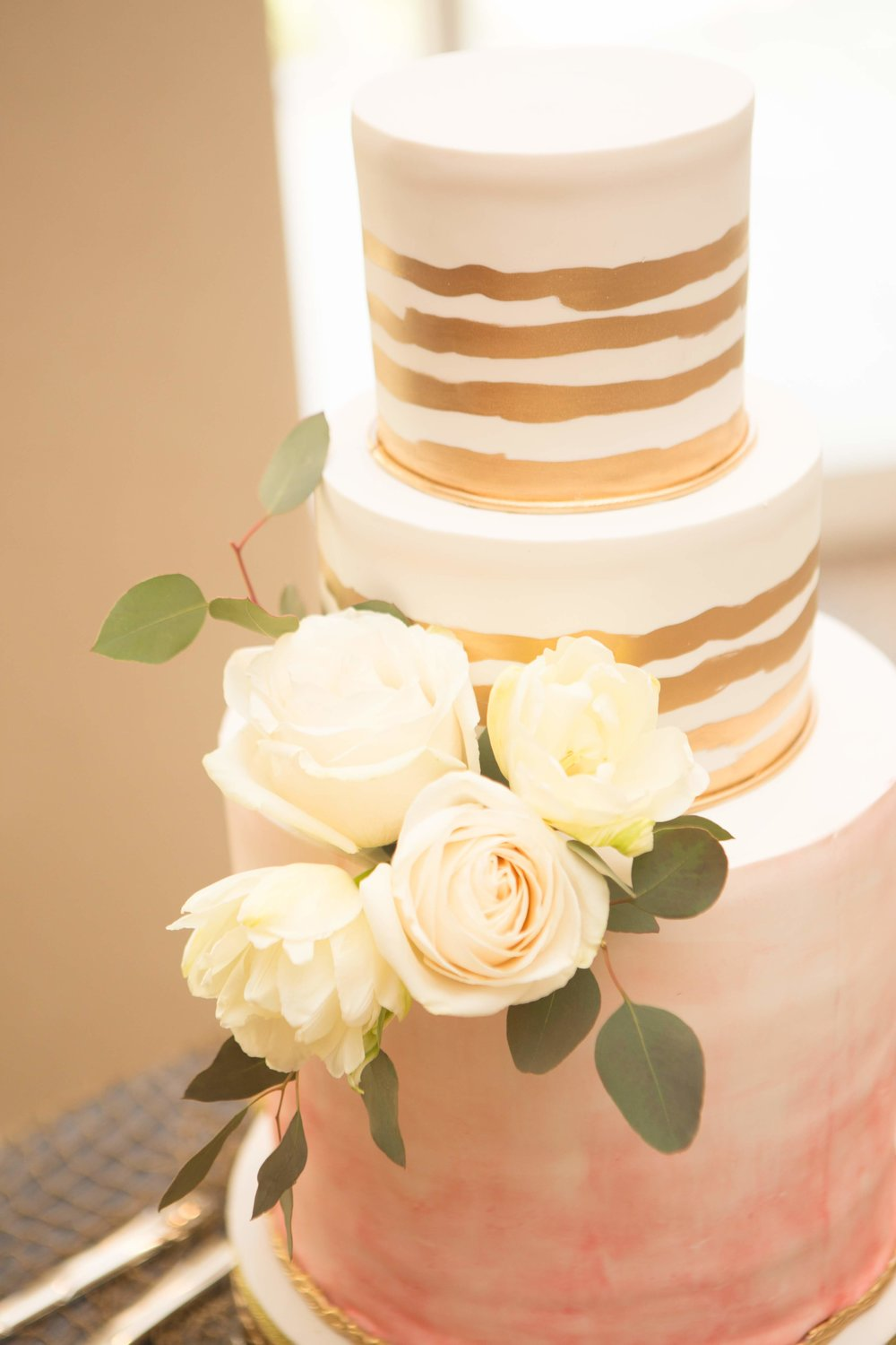 Simple wedding cake flowers at Miami Beach wedding