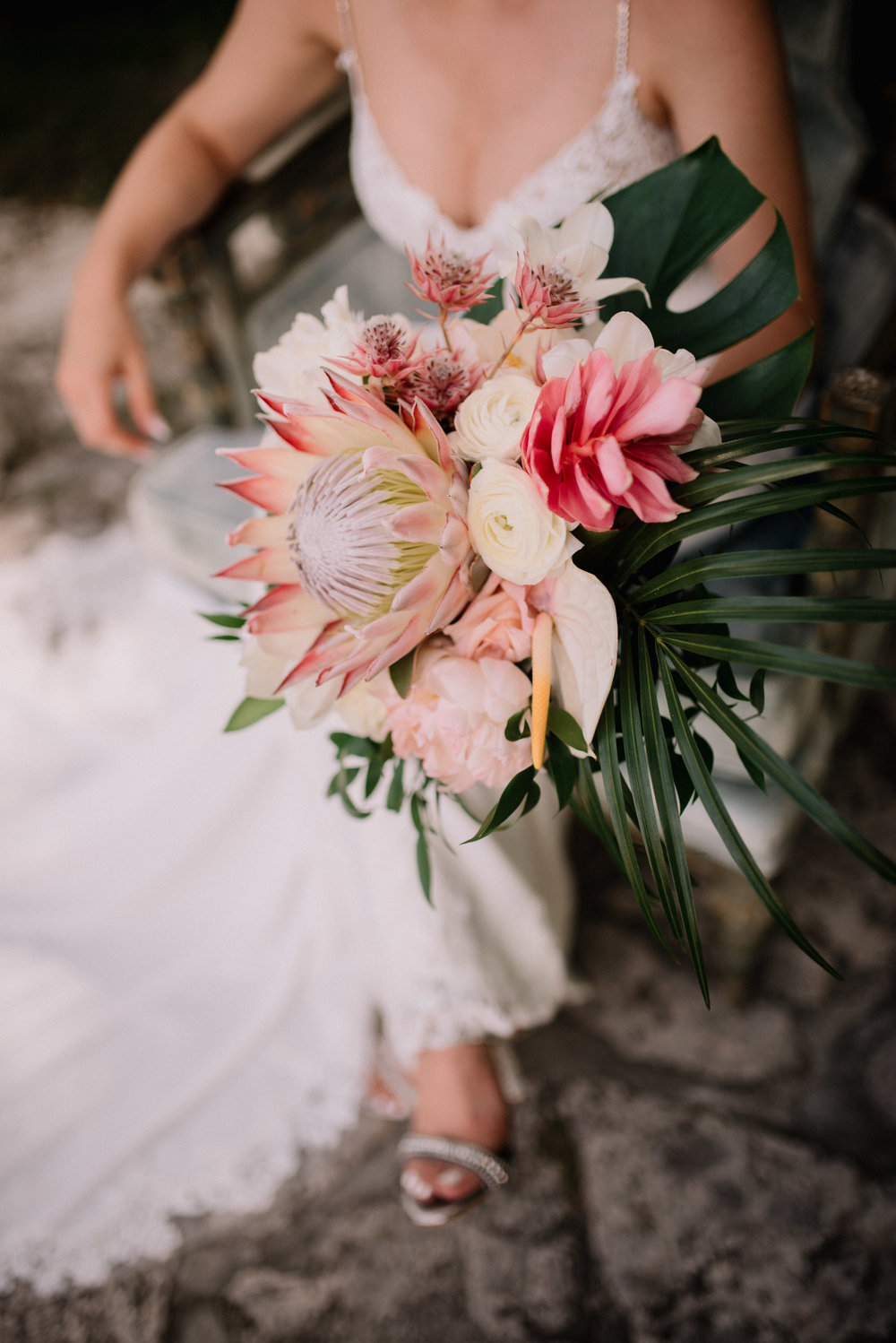 Stunning and dramatic tropical bride bouquet in pink and blush held by bride at  Deering Estate  wedding in Miami