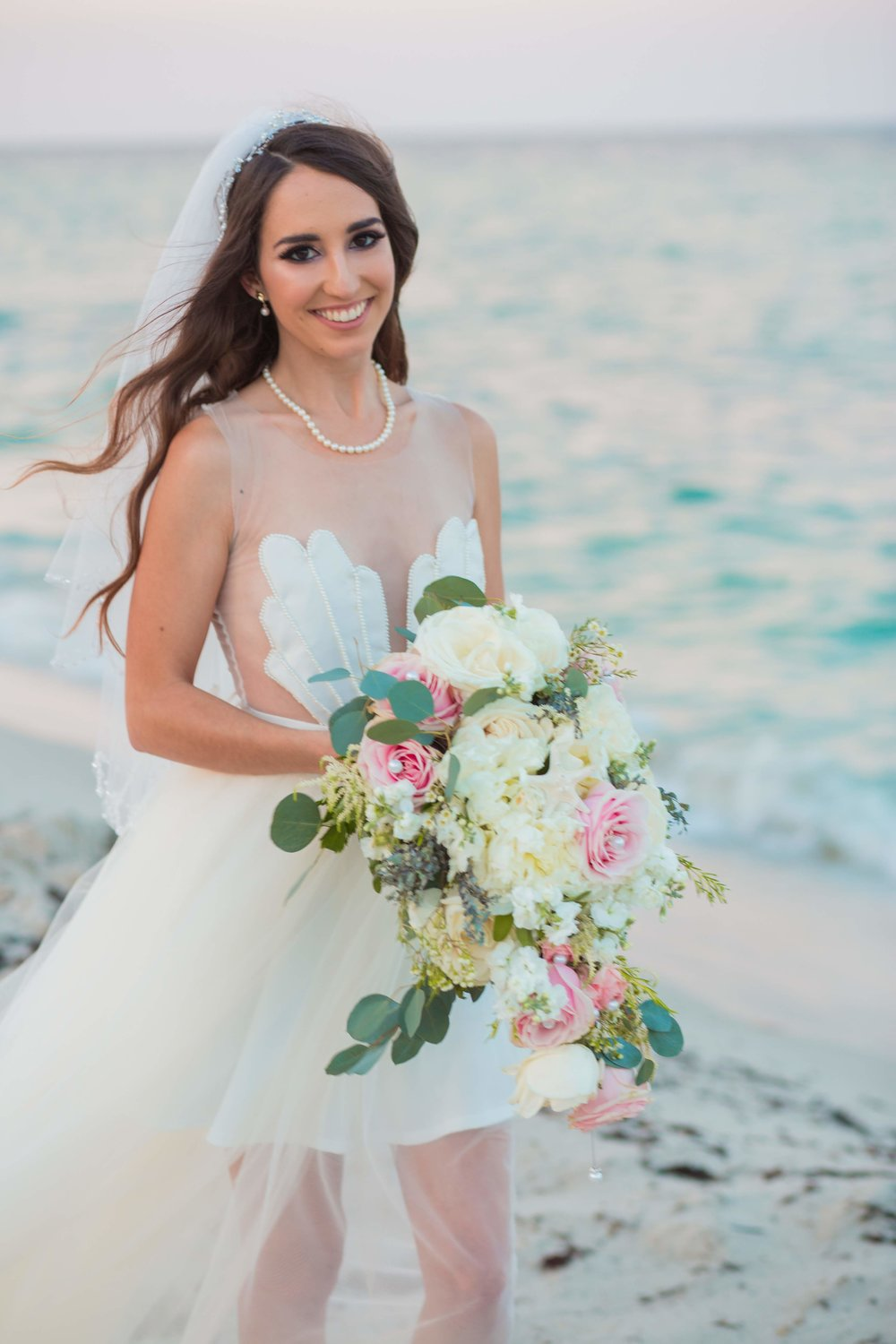 Look closely at the petals in her bouquet!  Fun Fact : Mermaid Jules made her dress!