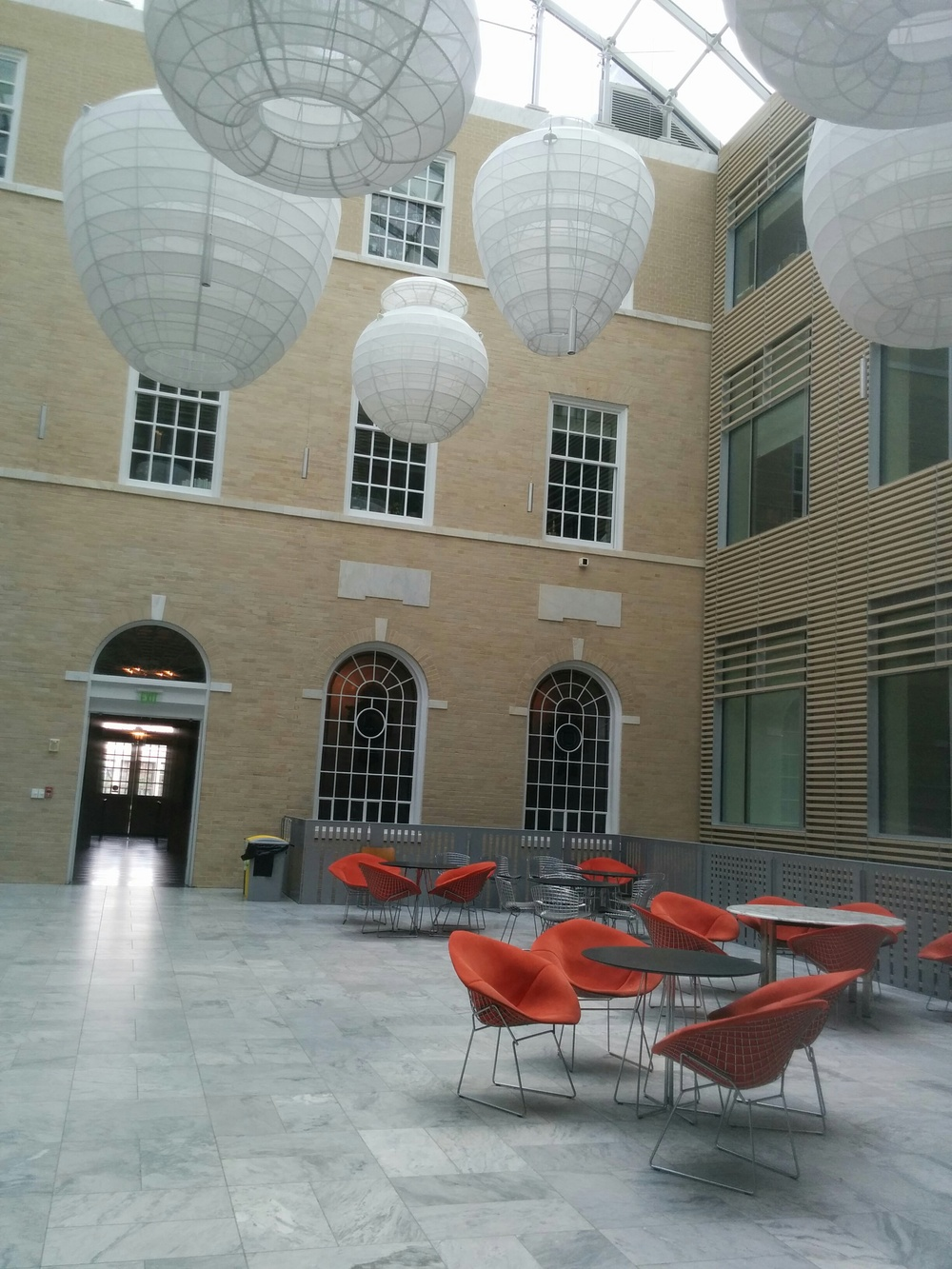 A common area in Gilman Hall, home to many humanities departments and the  Archaeological Museum  (hence the artifact-shaped lights).
