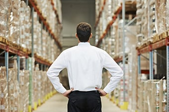 3G Logistics Christchuch | Freight Management | Man managing warehouse stock in New Zealand