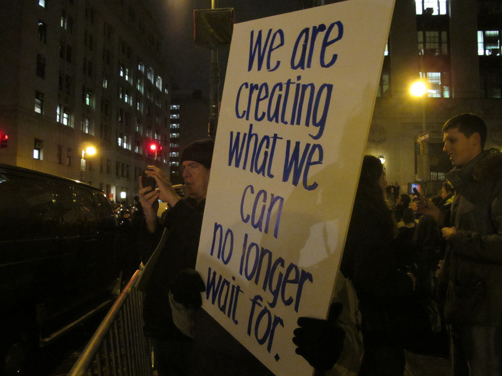Protestors march across downtown New York to mark the one-month anniversary for Occupy Wall Street.