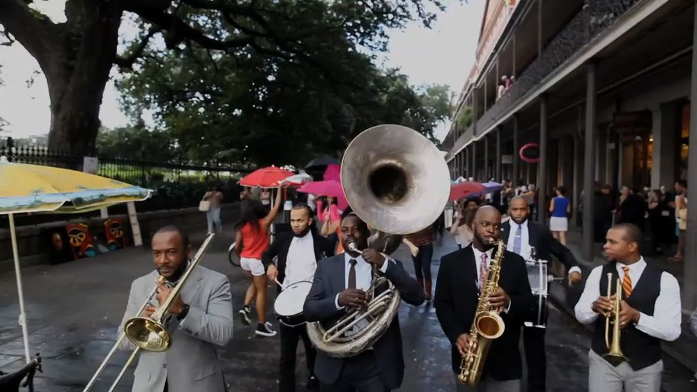 A little rain didn't stop this amazing second line...