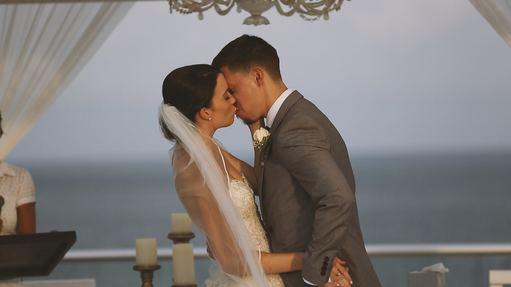 Such a romantic first kiss overlooking the ocean!
