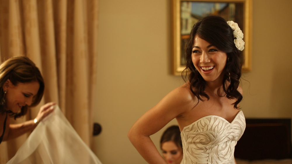 Laura was all smiles putting on her gorgeous wedding gown.