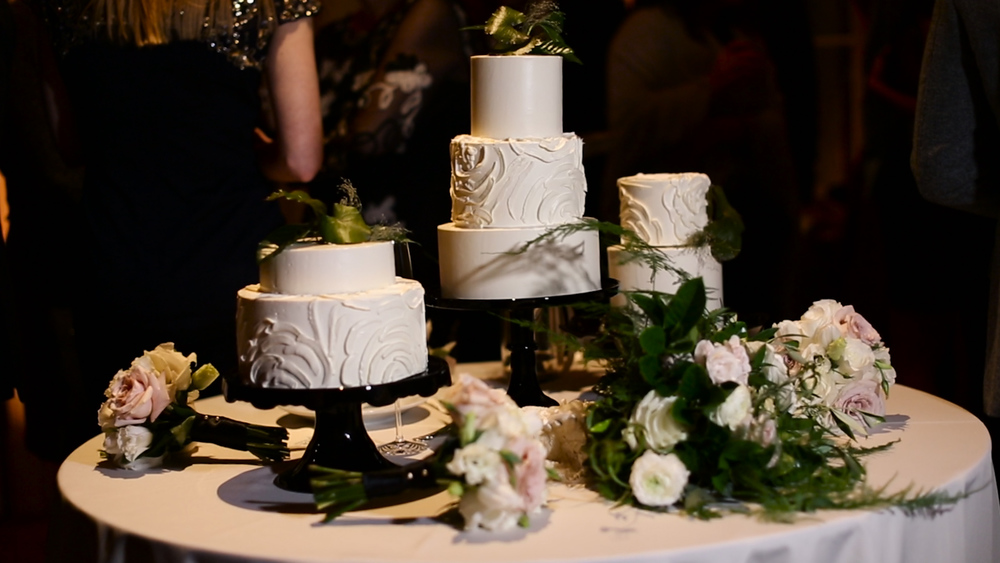 Melissa's Fine Pastries did an amazing job mimicking the lines of Laura's dress on the three beautiful wedding cakes.