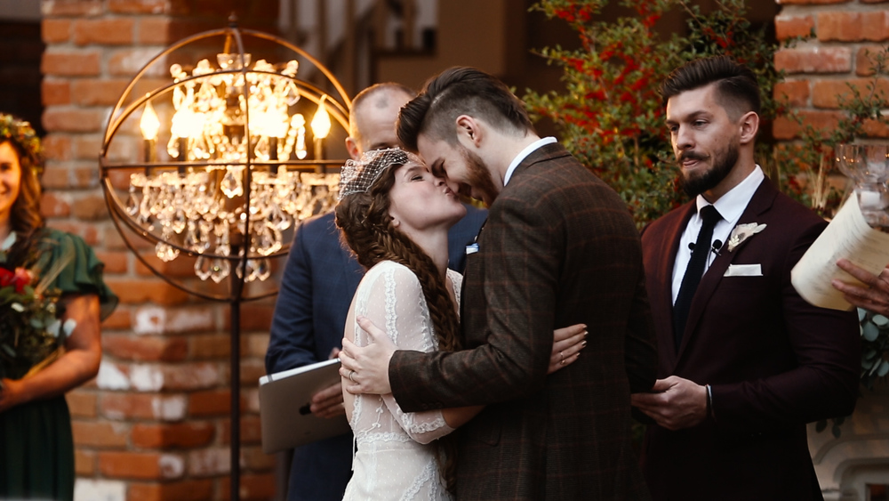 More nose kisses in front of the gorgeous, modern chandeliers.