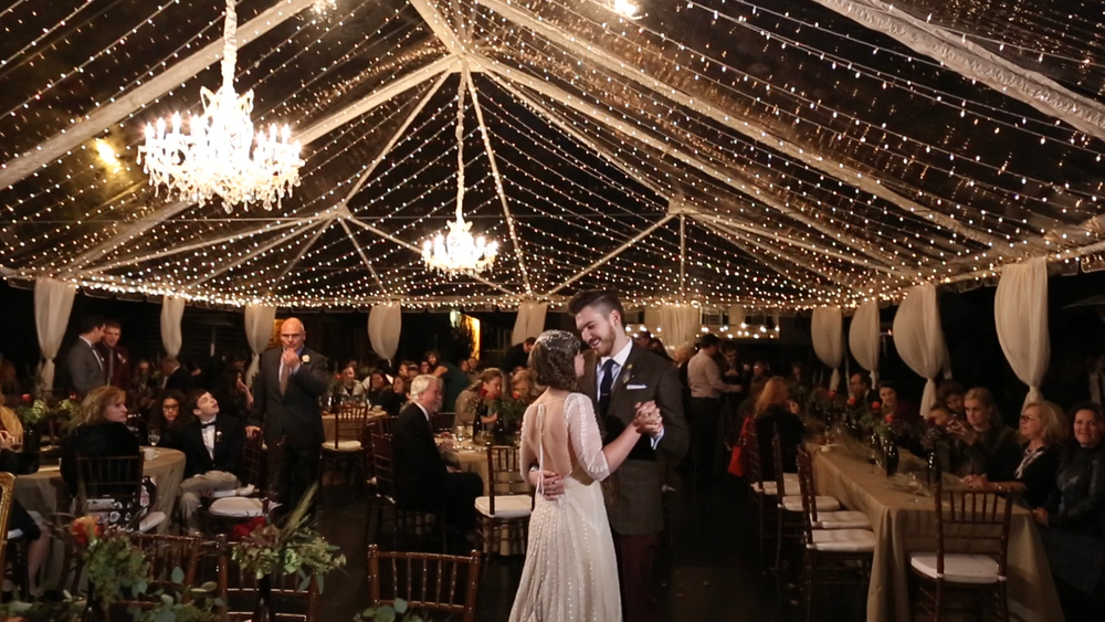 The romantic string lights helped the tent glow with the help of a couple gorgeous chandeliers.