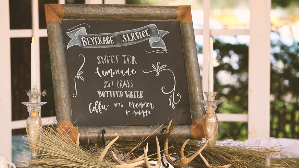 Beautiful hand drawn signs accented the reception.