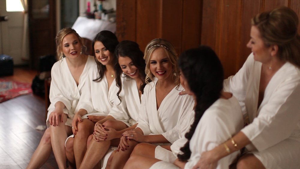 All of the bridesmaids wore matching white robes while doing their hair and makeup.