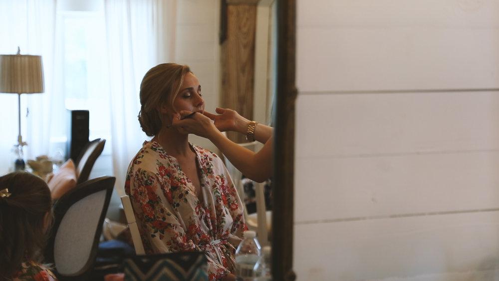 Amanda and Hayden_The White Magnolia Farm Weddings_New Orleans videographer_Bride prep in floral robe