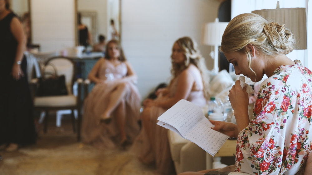 Amanda and Hayden_The White Magnolia Farm Weddings_New Orleans videographer_Bride reading letter
