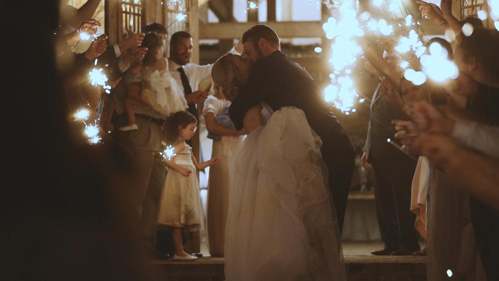 Amanda and Hayden_The White Magnolia Farm Weddings_New Orleans videographer_wedding Sparkler exit kiss
